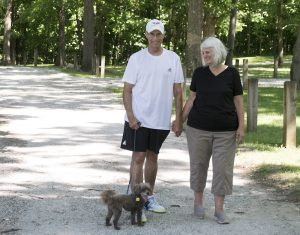After suffering from a heart attack on the tennis court in July 2017, Steven Huntley enjoys taking walks with his wife, Linda, and dog, Coco, to help him stay healthy.