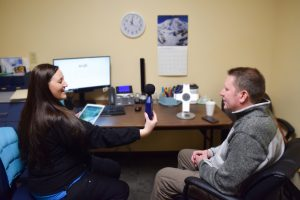 Steve Breitwieser works with Riverview Health speech pathologist Carah Sullenbarger to improve his vocal loudness and articulation.