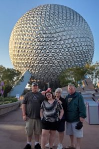 During a 2019 spring break trip to Disney with his family, John Cook (far right), was suffering from so much knee pain that he had to rent a power chair for a portion of the trip. But after a successful knee replacement with Dr. Scott Smith at Riverview Health in 2020, John says he is looking forward to traveling again without pain.