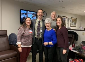 Sharon (center) was joined by her family to celebrate her last day of chemotherapy at Riverview Health on Oct. 30, 2019. Two of Sharon's children—Dr. Eric Marcotte (left) and Betsy Zile, NP (far left)—are also Riverview Health employees, something that made Sharon feel even more at home at the hospital.