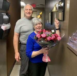 Sharon poses with her husband, John, as she rings the bell to celebrate her last day of chemotherapy.